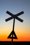 Australasian;Australia;Australian;Burra;cross;crosses;dusk;evening;level-crossing;level-crossings;morning;nightfall;orange;rail;rail-crossing;rail-crossings;railroad;railroads;railway;railway-crossing;railway-crossings;railways;S.A.;SA;signage;signs;silhouette;silhouettes;sky;South-Australia;sunset;sunsets;tracks;train;trains;transport;transportation;twilight;warn;warning;warning-sign;warning-signs;x