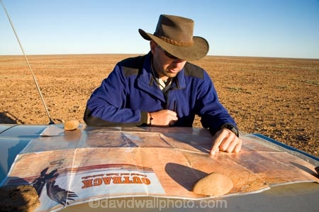 akubra;akubras;arid;Australasia;Australia;Australian;Australian-Desert;Australian-Deserts;Australian-Outback;back-country;backcountry;backwoods;chart;compass;country;countryside;desert;Deserts;direction;directions;dry;exploration;explore;geographic;geography;in-the-middle-of-nowhere;journey;lost;man;map;map-reading;maps;navigate;navigation;Outback;people;person;reading-map;red-centre;remote;remoteness;road-trip;road-trips;route;rural;S.A.;SA;South-Australia;Strezlecki-Track;Strezleki-Track;Strzelecki-Track;travel;traveling;travelling;wilderness