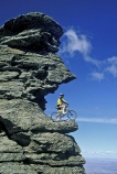 on-the-edge;bike;cycle;cyclist;biker;bikes;cycles;bicycle;bicycles;outcrop;outcrops;-rocks;high-country;cliff;cliffs;bluff;bluffs;danger;dangerous;exciting;adventure;sports;overhang;sky;mountain;biking;cycling;