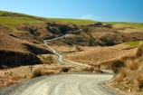 countryside;dusty;gravel-road;gravel-roads;Lake-Mahinerangi;lawrence;metal-road;metal-roads;metalled-road;metalled-roads;N.Z.;New-Zealand;NZ;Otago;road;roads;rural;S.I.;SI;South-Is;South-Island;Sth-Is;tussock;Tussocks;unpaved-road;unpaved-roads