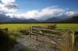 agricultural;agriculture;black-cloud;black-clouds;cloud;cloudy;country;countryside;dark-cloud;dark-clouds;farm;farming;Farmland;farms;fence;fenceline;fencelines;fences;field;fields;Fiordland;Fiordland-N.P;Fiordland-National-Park;Fiordland-NP;gate;gates;gateway;gateways;grey-cloud;grey-clouds;Manapouri;meadow;meadows;mountain;mountains;N.Z.;national-park;national-parks;New-Zealand;NZ;paddock;paddocks;pasture;pastures;peak;peaks;rain-cloud;rain-clouds;range;ranges;rural;S.I.;SI;South-Island;south-west-new-zealand-world-heritage-area;Southland;storm;storm-clouds;storms;stormy;te-wahipounamu;te-wahipounamu-south_west-new-zealand-world-heritage-area;world-heirtage-site;world-heritage-area