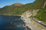 aerial;aerial-photo;aerial-photography;aerial-photos;aerial-view;aerial-views;aerials;articulated-truck;articulated-trucks;coast;coastal;coastline;coastlines;coasts;driving;highway;highways;Kaikoura;Kaikoura-Coast-Road;Kiwi-Experience;lorries;lorry;Marlborough;N.Z.;New-Zealand;NZ;ocean;open-road;open-roads;Raramai-Tunnel;Raramai-Tunnels;road;road-trip;road-tunnel;road-tunnels;roads;rugged;S.I.;sea;Seaward-Kaikoura-Range;Seaward-Kaikoura-Ranges;shore;shoreline;shorelines;shores;SI;South-Island;State-Highway-1;State-Highway-one;transport;transportation;travel;traveling;travelling;trip;truck;trucks;tunnel;tunnels;water