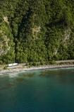 aerial;aerial-photo;aerial-photography;aerial-photos;aerial-view;aerial-views;aerials;articulated-truck;articulated-trucks;coast;coastal;coastline;coastlines;coasts;driving;highway;highways;Kaikoura;Kaikoura-Coast-Road;lorries;lorry;Marlborough;N.Z.;New-Zealand;NZ;ocean;open-road;open-roads;road;road-trip;roads;rugged;S.I.;sea;Seaward-Kaikoura-Range;Seaward-Kaikoura-Ranges;shore;shoreline;shorelines;shores;SI;South-Island;State-Highway-1;State-Highway-one;transport;transportation;travel;traveling;travelling;trip;truck;trucks;water