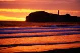 beach;beaches;Castle-Point-Lighthouse;coast;coastal;coastline;color;colors;colour;colours;dawn;headland;light-house;light-houses;lighthouse;lighthouses;North-Island;ocean;orange;Pacific;promontory;shore;shoreline;sunrise;Wairarapa