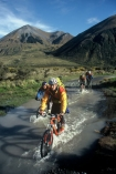bicycle;bicycles;bike;biker;bikes;biking;cycle;cycling;cyclist;excercise;excercising;healthy;mountain;mountains;multi-sport;multi_sport;multisport;outdoor;outdoors;outside;pedal;pedaling;pedals;puddle;race;racing;recreation;splash;splashing;wheel;wheels