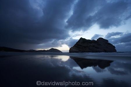 Archway-Is;Archway-Is.;Archway-Island;Archway-Islands;beach;beaches;black-cloud;black-clouds;calm;cloud;cloudy;coast;coastal;coastline;dark-cloud;dark-clouds;dusk;evening;foreboding;foreshore;geological;geology;grey-cloud;grey-clouds;N.Z.;Nelson-Region;New-Zealand;nightfall;North-West-Nelson-Region;NZ;Pilch-Point;placid;quiet;rain-cloud;rain-clouds;reflection;reflections;rock;rock-formation;rock-formations;rock-outcrop;rock-outcrops;rock-tor;rock-torr;rock-torrs;rock-tors;rocks;S.I.;sand;sandy;serene;shore;shoreline;SI;sky;smooth;South-Is.;South-Island;still;stone;storm;storm-clouds;storm-front;storm_front;stormfront;storms;stormy;Tasman-Sea;threatening;tranquil;twilight;water;Wharariki-Beach