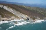 aerial;aerial-photo;aerial-photograph;aerial-photographs;aerial-photography;aerial-photos;aerial-view;aerial-views;aerials;bluff;bluffs;cliff;cliffs;coast;coastal;coastline;coastlines;coasts;Curious-Cliff;Curious-Cliffs;Mount-Lunar;Mt-Lunar;Mt.-Lunar;N.Z.;Nelson-Region;New-Zealand;North-West-Coast;Northern-West-Coast;NZ;ocean;S.I.;sea;Sea-Cave;Sea-Caves;shore;shoreline;shorelines;shores;SI;South-Is.;South-Island;steep;surf;Tasman-Sea;water;waves