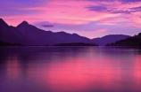 alpine;mountain;mountains;Queenstown;south-island;new-zealand;sky;effect;lighting;unusual;last-light;sunlight;ray;twilight;lake;lakes;lake-wakatipu;wakatipu;colour;color;warm;pink;pinkish;sunset;reflection;reflections;calm;peaceful;peacefulness;calmness
