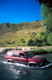 maroon;vehicle;river-crossing;fords;Toyota;toyota-hilux;surf;river;rivers;hilux-surf;toyota-hilux-surf;wake;wet;dry-crossing;wheels;transport;transportation;rugged;wild;wilderness;outdoors;leisure;pleasure;ford;cross;crossing;4x4;4wd;four-by-four;four-wheel-drive