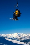 chair-lift;holiday;lift;seated;sitting;ski;skier;skiers;skiing;skis;transport;transportation;vacation