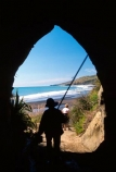 cave;bay-beach;sand;caves;coast;sea-cave;erosion;tourism;tourist;tourists;water;cattle;history;stock-movement;past;agriculture;silhouette.-fisherman;fishing;elderly;retired;holiday